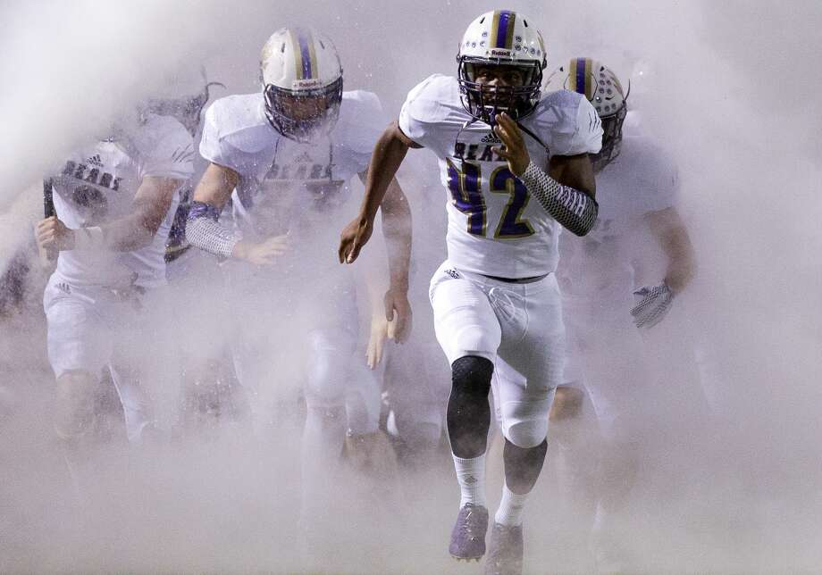 Montgomery defensive tackle Kenyura Hill (42) leads the team onto the field before a District 12-6A high school football game against Oak Ridge at Woodforest Bank Stadium, Friday, Oct. 6, 2017, in Shenandoah. Photo: Jason Fochtman/Houston Chronicle