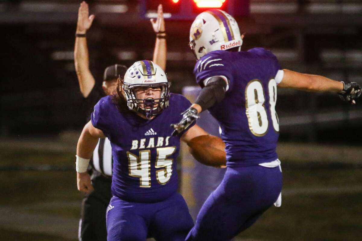 Montgomery's Daniel Dobis (45) celebrates scoring a touchdown with Jody Miller (88) during the varsity football game against The Woodlands on Friday, Nov. 3, 2017, at Bears Stadium in Montgomery. Dobis will start for a third year for the Bears. (Michael Minasi / Houston Chronicle)