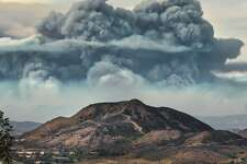 Professional photographer Greg Vitalich took this photo of the massive imposing smoke generated by the Thomas Fire from his back deck in Newbury Park on Dec. 11, 2017, at 11:45 a.m.
