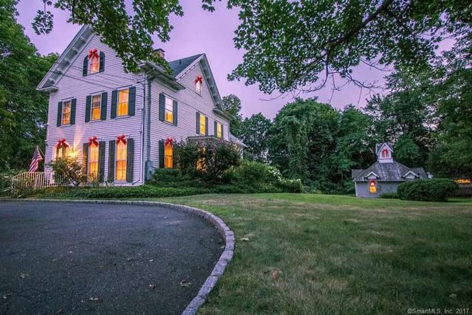The 5,500-square-foot house sits on a property of almost one acre and includes a vintage boat house and guest cottage, which is a legal rental property.