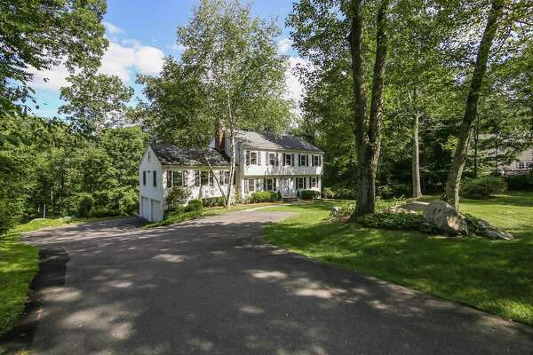 The renovated 10-room house at 42 Thunder Lake Road was built in 1983 on a two-acre lot that is within walking distance of Weir Farm National Historic Site and the Wilton Town Forest.