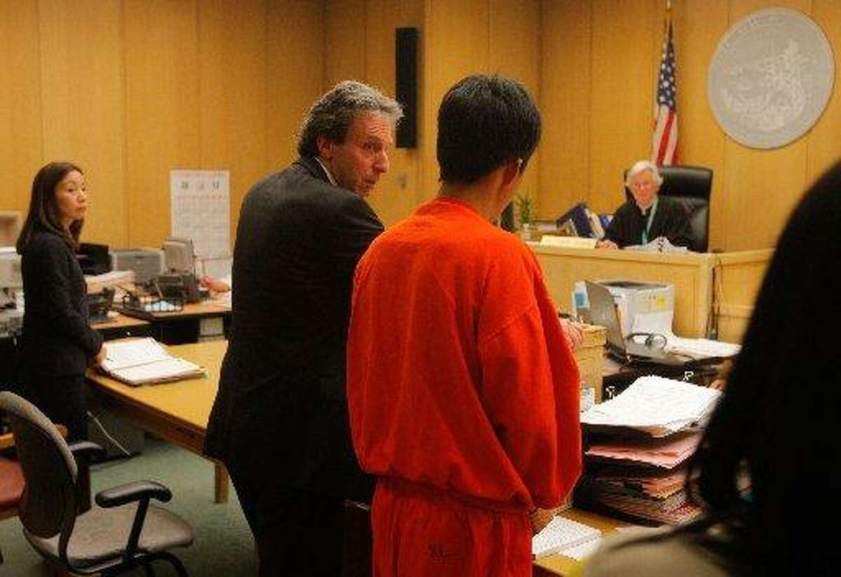 FILE-- Binh Luc stands in San Francisco Superior Court shortly after his 2012 arrest.