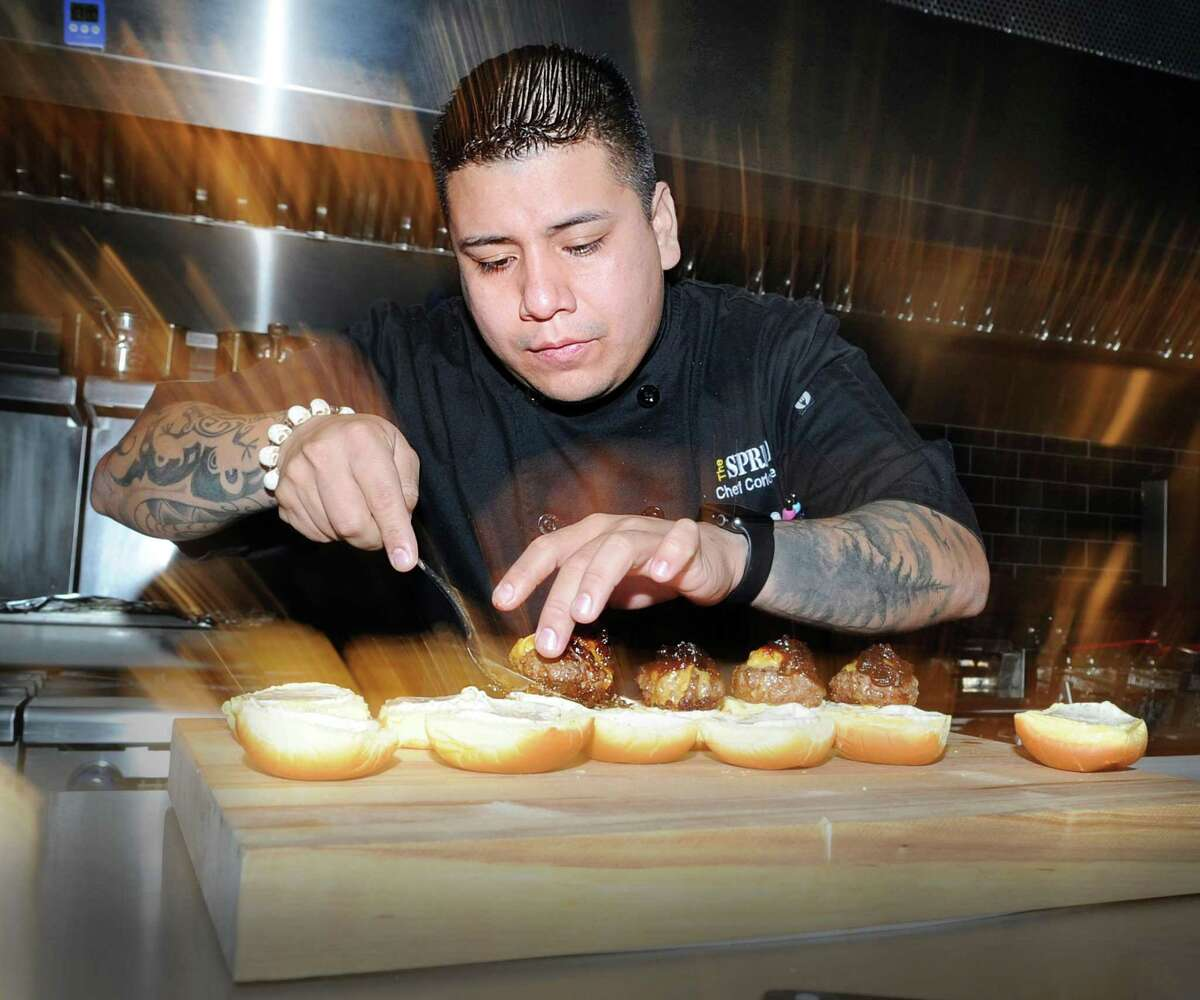 Chef Carlos Baez prepares Kobe beef sliders during the media night preview at The Spread restaurant in Greenwich, Conn. The new restaurant will sit at the bottom floor of the Audubon apartment complex and feature both indoor and outside seating in accordance with COVID-19 guidelines. In addition, the restaurant will boast El Segundo's signature unlimited Taco Tuesday.