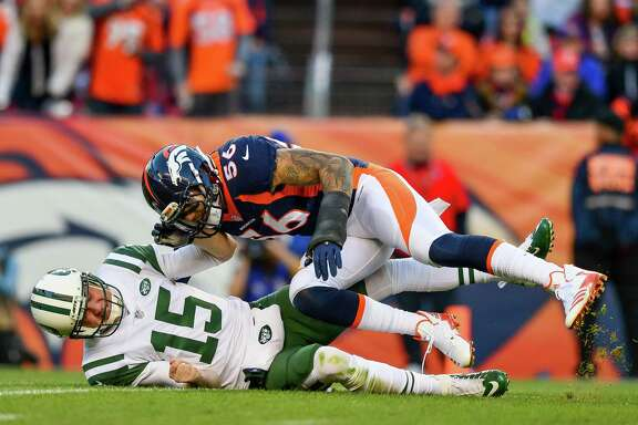 DENVER, CO - DECEMBER 10:  Outside linebacker Shane Ray #56 of the Denver Broncos hits quarterback Josh McCown #15 of the New York Jets on a play where McCown would appear to injure his left hand and come out of the game in the third quarter of a game at Sports Authority Field at Mile High on December 10, 2017 in Denver, Colorado.