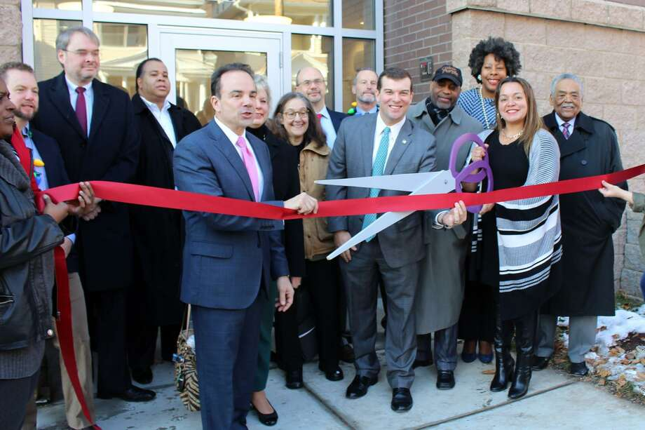 City and State officials joined Bridgeport Neighborhood Trust to cut the ribbon on the Westgate Apartment. Photo: Jordan Grice / Hearst Connecticut Media / Connecticut Post