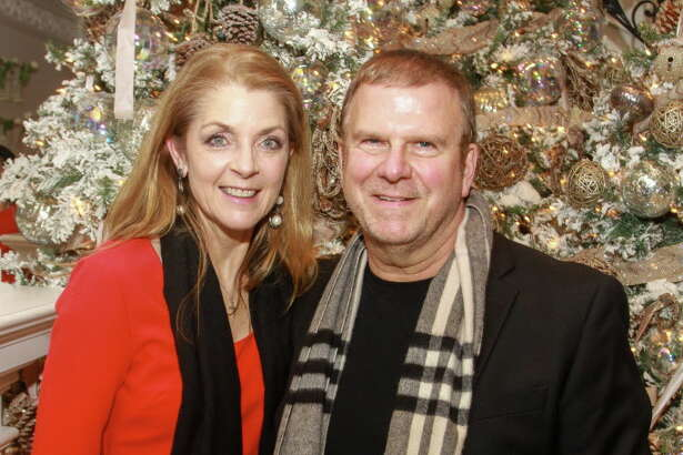 Paige and Tilman Fertitta at the 12th Annual Santa?'s Elves Party to benefit pediatric cancer research at MD Anderson Cancer Center Children'?s Cancer Hospital.