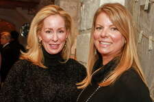 Gretchen Wright, left, and Rachelle Rowe at the 12th Annual Santa?'s Elves Party to benefit pediatric cancer research at MD Anderson Cancer Center Children'?s Cancer Hospital.