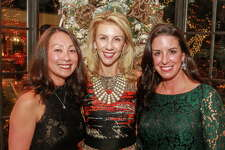 Mary Atherton, from left, Catherine Herr and Jody Martin at the 12th Annual Santa?'s Elves Party to benefit pediatric cancer research at MD Anderson Cancer Center Children'?s Cancer Hospital.