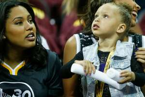 Ayesha Curry, left, Stephen Curry's wife, and daughter, Riley, are seen prior to the start of Game 6 of The NBA Finals between the Golden State Warriors and Cleveland Cavaliers at The Quicken Loans Arena on Tuesday, June 16, 2015 in Cleveland, Ohio.