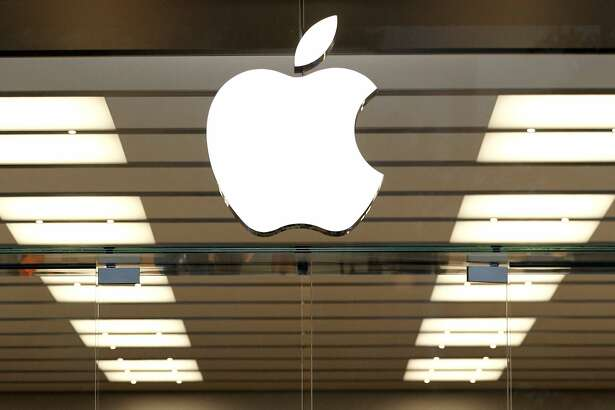 FILE - This Thursday, Sept. 19, 2013, file photo shows the Apple logo above a store location entrance in Dallas. Apple has bought Shazam, the maker of a song-recognition app that Apple's digital assistant Siri has already been using to help people identify the music playing on their iPhones. (AP Photo/Tony Gutierrez, File)