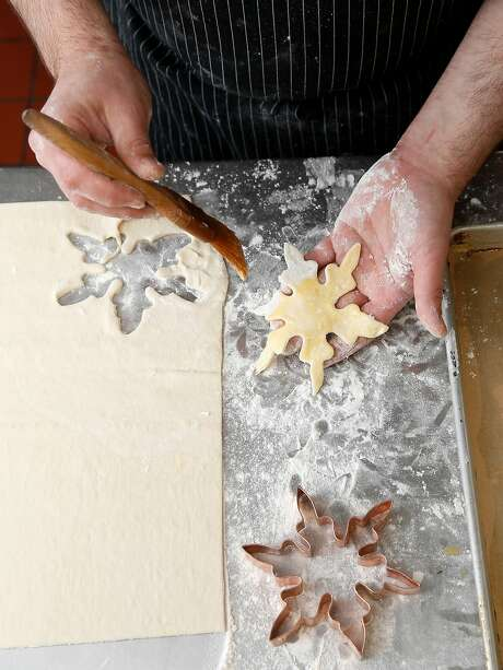 Chef Blake Askew makes snowflake decorations from dough for his  beef wellington at Maybeck's on Tuesday, November 29, 2017, in San Francisco, Calif. Photo: Liz Hafalia, The Chronicle