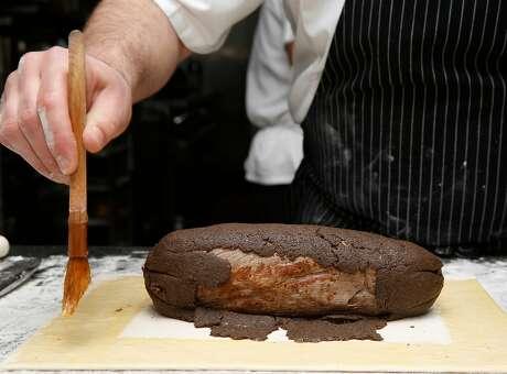 Chef Blake Askew prepares beef wellington at Maybeck's on Tuesday, November 29, 2017, in San Francisco, Calif. Photo: Liz Hafalia, The Chronicle