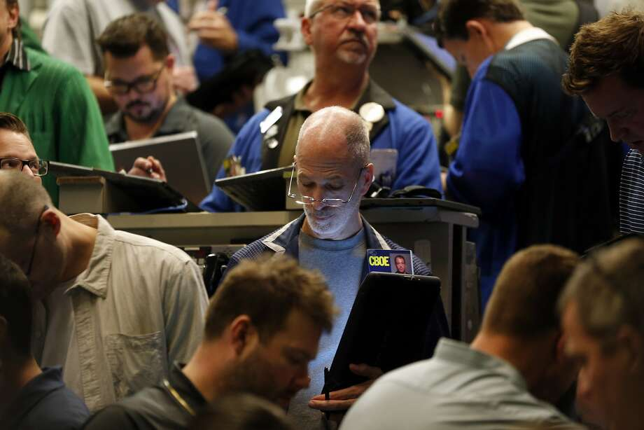 Traders work in a trading pit at the Chicago Board Options Exchange, where trading in Bitcoin futures began on Sunday evening. Photo: Kiichiro Sato, Associated Press