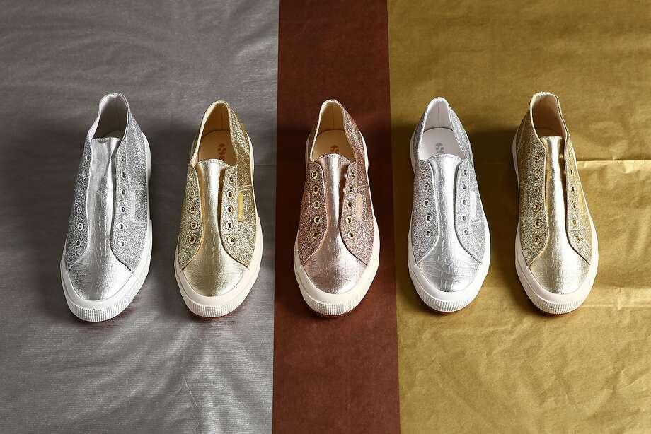 Claudia Volpi's stand-alone Superga boutique on Fillmore Street offers a variety of styles from the Italian tennis shoe maker that are not offered in other stores, including these women's laceles, metallic microglitter sneakers in bronze for $89 and silver for $99 (rose gold, pictured in center, is not available.) Photo: Superga