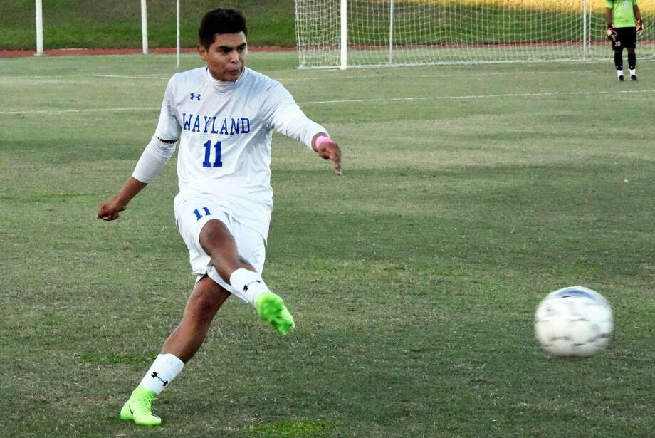 Jon Luna boots the ball during a Wayland Baptist men's soccer match this season. The Plainview High School graduate finished his four-year career for the Pioneers by helping them win an NAIA National Championship. Photo: Claudia Lusk/Wayland Baptist University