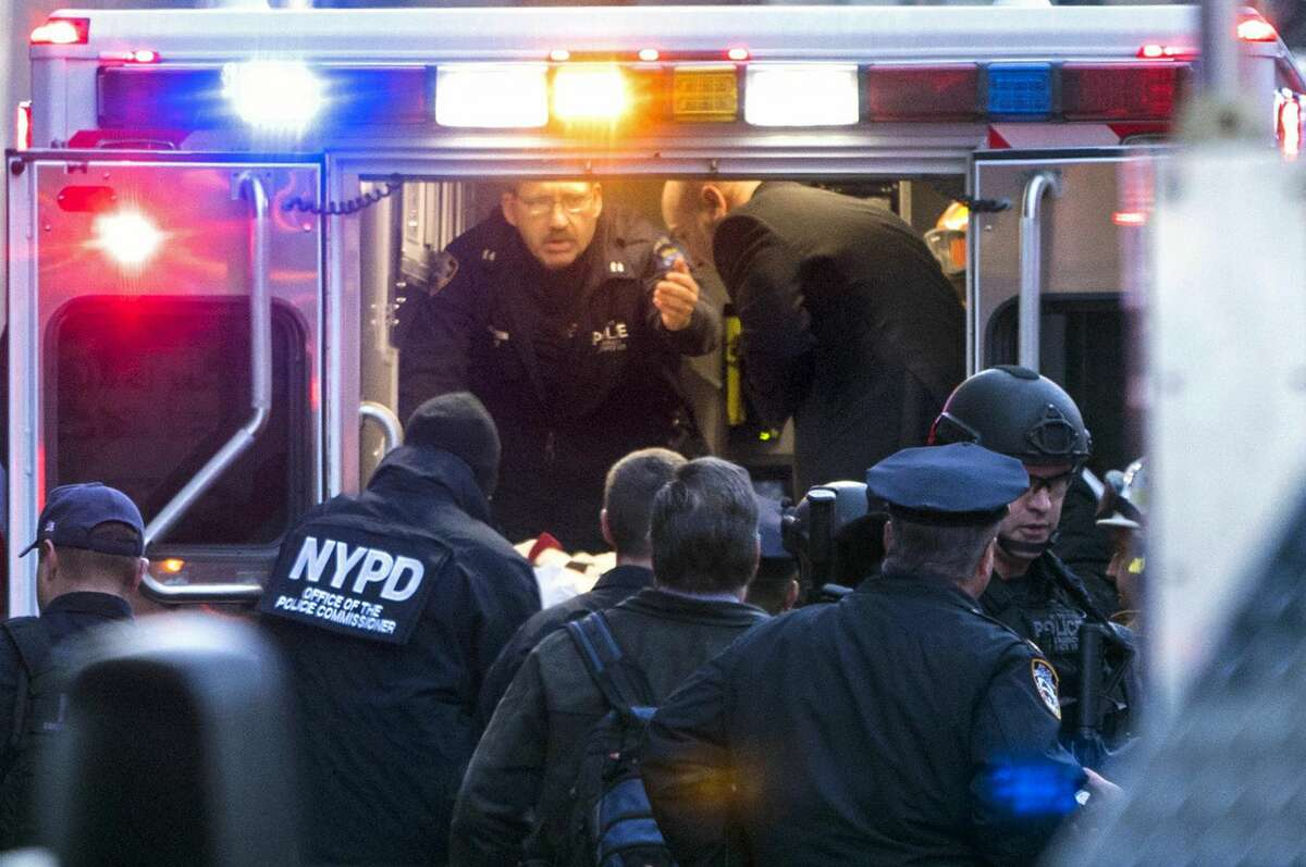 Officials place suspect Akayed Ullah, on a stretcher, into the back of an ambulance on Eighth Avenue between 42nd Street and 43rd Street, Monday, Dec. 11, 2017, in New York. Ullah is suspected of strapping a pipe bomb to his body and setting off the crude device in a passageway under 42nd Street between Seventh and Eighth Avenues, injuring himself and a few others.