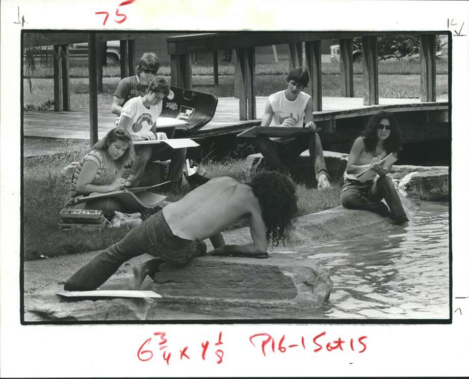 Students from the Art Institute of Houston sketch a model lounging on a rock in Bell Park, at the corner of Montrose and Milford in 1983. Photo: Larry Reese/Houston Chronicle