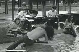 Students from the Art Institute of Houston sketch a model lounging on a rock in Bell Park, at the corner of Montrose and Milford in 1983.