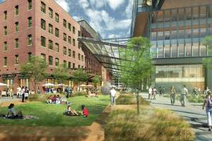 A street-level rendering of the planned new headquarters for General Electric in South Boston, which has been delayed by the new CEO as the company runs into problems in its new home.