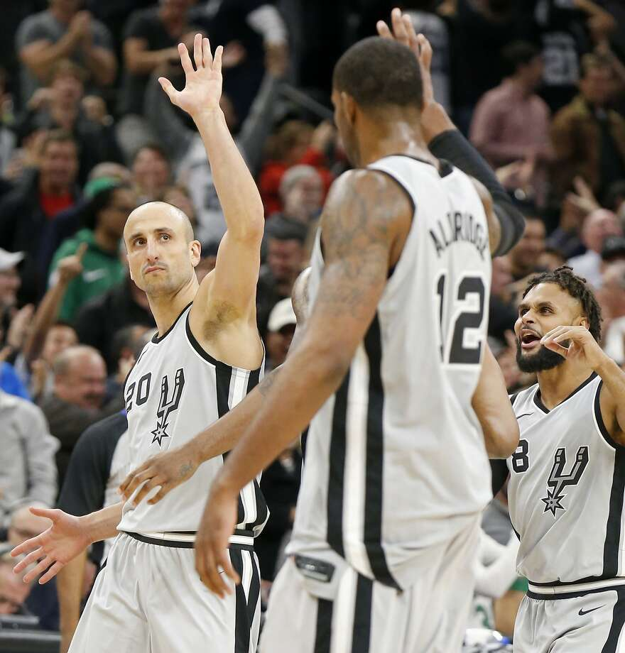 San Antonio Spurs guard Manu Ginobili (20) celebrates with teammates LaMarcus Aldridge (12), Rudy Gay (22), and Patty Mills (8) after making the game winning 3-pointer during second half action against the Boston Celtics Friday Dec. 8, 2017 at the AT&T Center. The Spurs won 105-102. Photo: Edward A. Ornelas, San Antonio Express-News