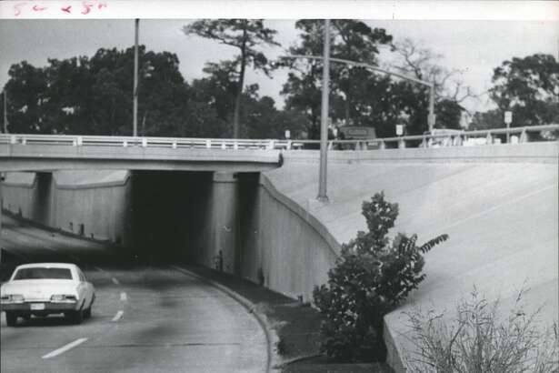 Allen Parkway, westbound near the Montrose underpass, displays giant weeds, some of them four feet high, in 1970.