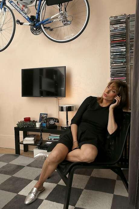 Amina Rubio says the rent on her Powell Street apartment rose 31 percent overnight. Photo: Liz Hafalia, The Chronicle