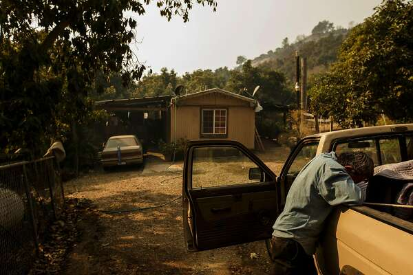 Arnulfo Basabe breaks down, weeps and prays on Monday, Dec. 11, 2017 after he discovers his trailer home is still standing in a Stanley Park Road neighborhood that was mostly destroyed by the Thomas Fire, near Carpinteria, Calif. (Marcus Yam/Los Angeles Times/TNS)