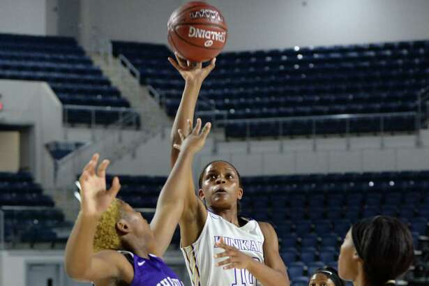 Jasmine Smith (10) of Kinkaid makes a jump shot during the second quarter of the championship game in the Houston ISD Varsity Girls Tournament between the Kinkaid Falcons and the Wheatley Wildcats on Saturday December 2, 2017 at Delmar Fieldhouse, Houston, TX.