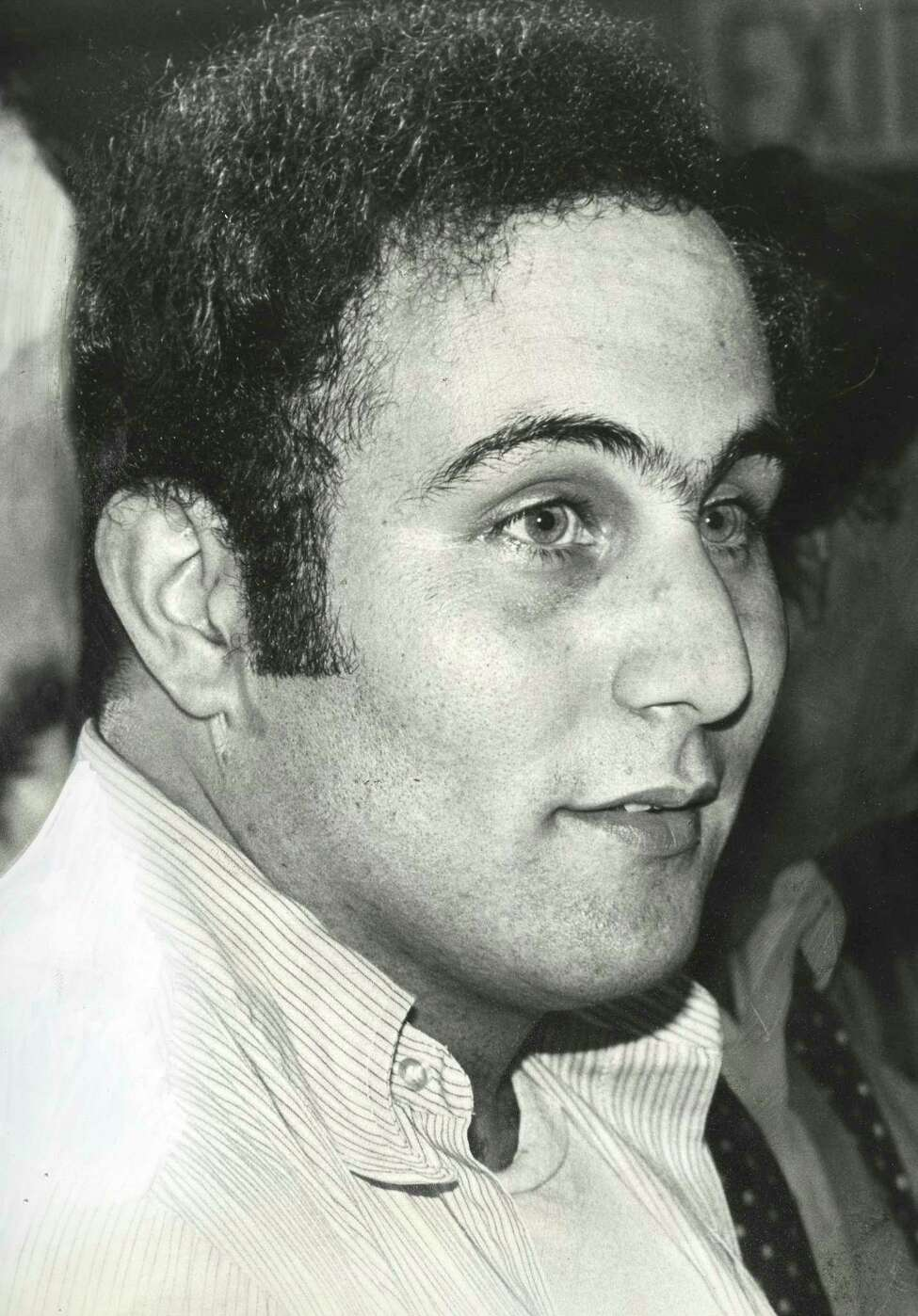 FILE -- David Berkowitz, the .44-caliber killer, in police custody in New York, Aug. 11, 1977. (Fred R. Conrad/The New York Times)