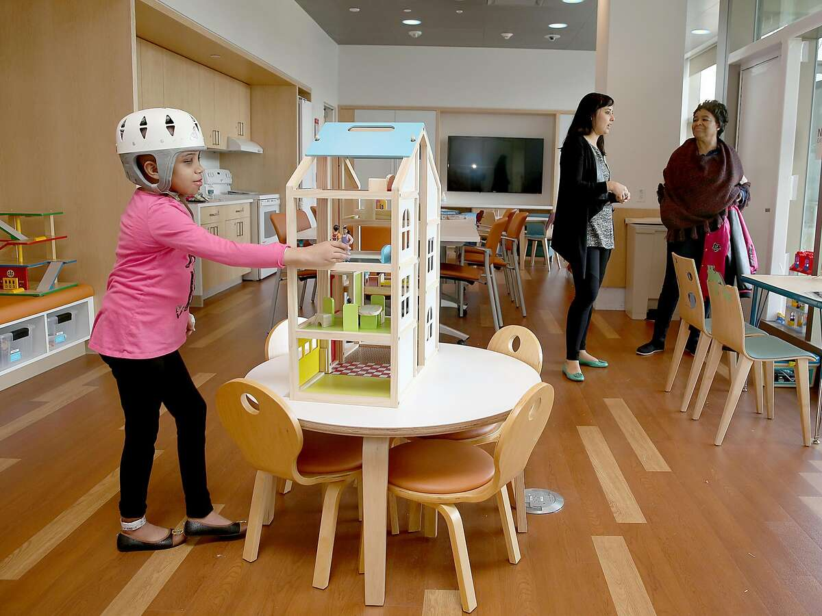 Patient Kiera Ellis (front left), 10 years old, plays in the Connie and Bob Lurie playroom at the new building of Lucile Packard Children's Hospital on Wednesday, December 6, 2017, in Palo Alto, CA.