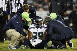 JACKSONVILLE, FL - DECEMBER 10:   Mike Davis #39 of the Seattle Seahawks sits on the field after an injury during the second half of their game against the Jacksonville Jaguars at EverBank Field on December 10, 2017 in Jacksonville, Florida.  (Photo by Logan Bowles/Getty Images)