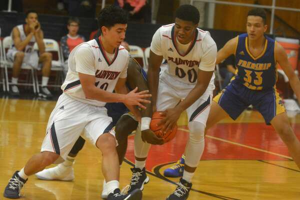 A Frenship player gets his hand on the ball to keep Plainview's Joseph Guy, 00, from handing it off to teammate Adrian Hinojosa, left, during a game earlier this season. The Bulldogs split four games at the Union Square Bulldog Classic in Burkburnett Thursday through Saturday.