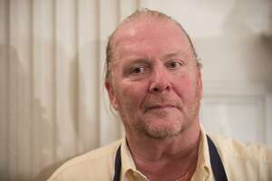 (FILES) This file photo taken on October 17, 2016 shows Chef Mario Batali at the White House in Washington, DC,  during a preview of the state dinner to be held for Italian Prime Minister Matteo Renzi and his wife Agnese Landini. Celebrity chef Mario Batali stepped away from his eponymous gastronomic empire on December 11, 2017, after multiple women accused him of sexual misconduct over the course of at least two decades. In allegations published by the food website Eater, four women speaking on condition of anonymity said Batali -- recognizable for his generous physique, flaming red ponytail and signature orange Croc shoes -- groped them and made inappropriate comments.  / AFP PHOTO / NICHOLAS KAMMNICHOLAS KAMM/AFP/Getty Images