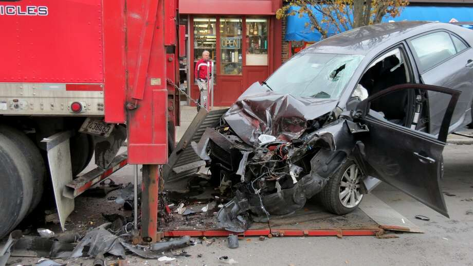 A car crashed into the back of a Coca-Cola delivery truck on New Scotland Avenue in Albany, N.Y., on Monday, Dec. 11, 2017. The driver was sent to Albany Med with injuries to his head and face. Photo: Tom Heffernan Sr./Special To The Times Union