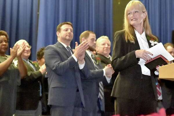 West Haven, Connecticut - Sunday,  December 3, 2017: West Haven Mayor Nancy Rossi is applauded after giving her inaugural address as the first woman mayor of West Haven during the City of West Haven Inaugural ceremonies Sunday afternoon  at West Haven High School.