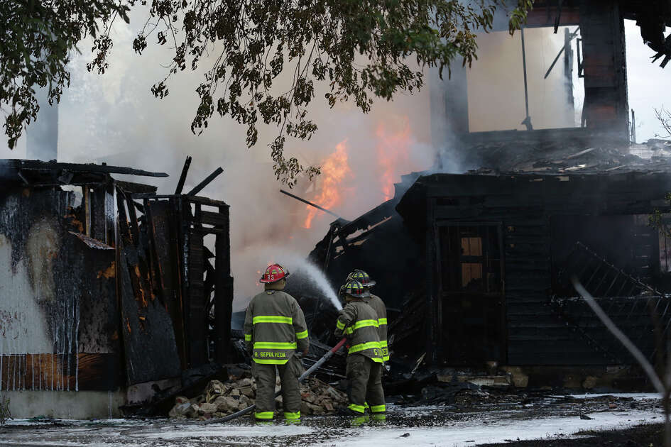 Fire fighters respond to a fire at 2100 West Travis St.on Monday , Dec. 11, 2017.