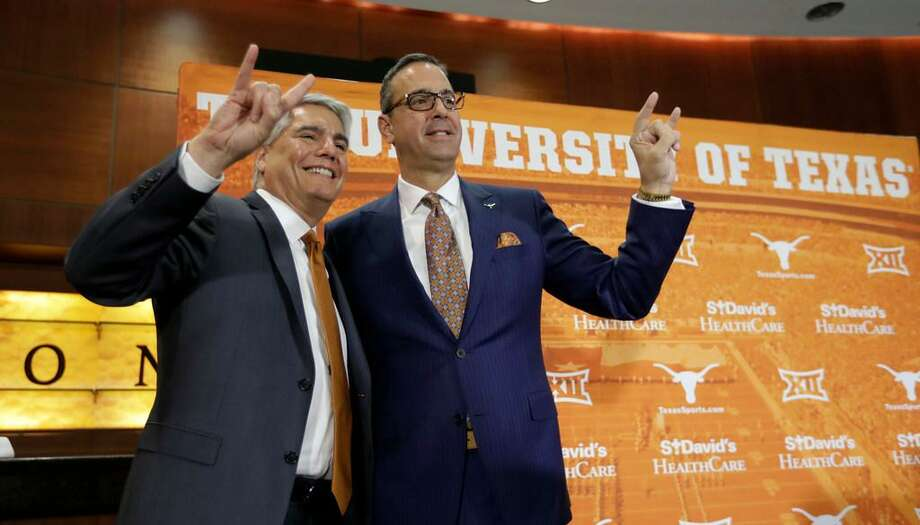 Texas president Greg Fenves, left, and Chris Del Conte, right, pose for a photo following a news conference where DelConte was introduced at the new vice president and athletics director for the University of Texas, Monday, Dec. 11, 2017, in Austin, Texas. Photo: Eric Gay /AP Photo