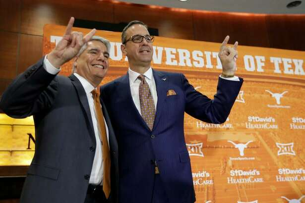 Texas president Greg Fenves, left, and Chris Del Conte, right, pose for a photo following a news conference where DelConte was introduced at the new vice president and athletics director for the University of Texas, Monday, Dec. 11, 2017, in Austin, Texas.
