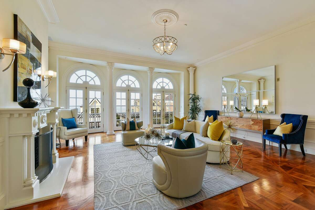 The living room at 2747 Vallejo St. in Pacific Heights boasts parquet flooring and a wood-burning fireplace.�
