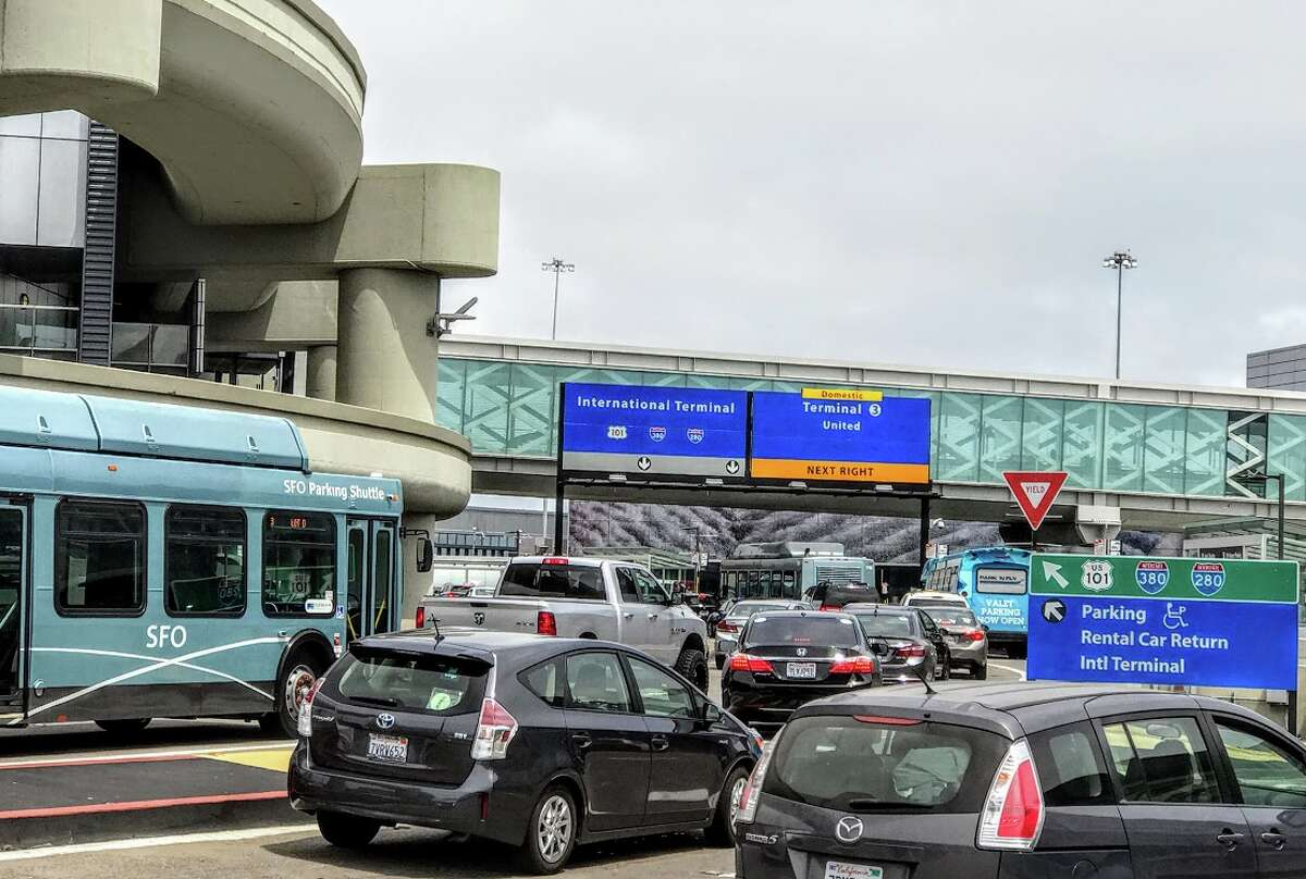 FILE-- Curbside pick-ups and drop-offs for Uber, Lyft and Wingz rides at San Francisco International Airport will cost more starting Sunday, July 1 when a new two-tier traffic congestion pricing system goes into effect.