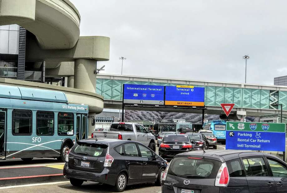 FILE-- Curbside pick-ups and drop-offs for Uber, Lyft and Wingz rides at San Francisco International Airport will cost more starting Sunday, July 1 when a new two-tier traffic congestion pricing system goes into effect. Photo: Chris McGinnis / TravelSkills