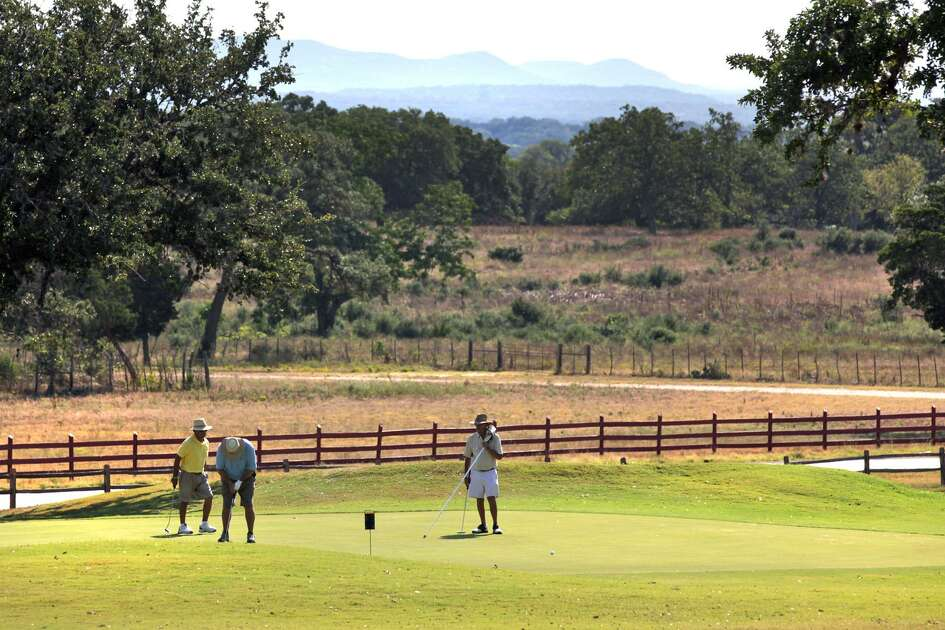 With spectacular views of the Texas Hill Country behind them, golfers putt out on the par 3 second hole at Flying L Golf Course in Bandera, TX, Monday, August 13, 2012. Most of the famed Flying L Hill Country Resort in Bandera County may be headed to foreclosure. The pilots' lounge, a conference center and 18-hole golf course are part of the property that may be headed to foreclosure. It couldn't immediately be determined if other parts of the resort, such as a water park and miniature golf course, would be included in a foreclosure. In May, the Texas Historical Commission backtracked from its assertion that Wright designed the lounge and other buildings on the ranch.