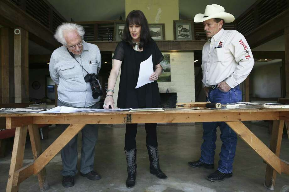 Susan and Jody Jenkins display evidence of celebrity visitations as William A. Storrer, expert on Frank Loyd Wright architecture, visits the Flying L Guest Ranch to inspect the pilot's lounge and guest villas on April 6, 2017. Most of the famed Flying L Hill Country Resort in Bandera County may be headed to foreclosure. The pilots' lounge, a conference center and 18-hole golf course are part of the property that may be headed to foreclosure. It couldn't immediately be determined if other parts of the resort, such as a water park and miniature golf course, would be included in a foreclosure. In May, the Texas Historical Commission backtracked from its assertion that Wright designed the lounge and other buildings on the ranch. Photo: Tom Reel /San Antonio Express-News / 2017 SAN ANTONIO EXPRESS-NEWS