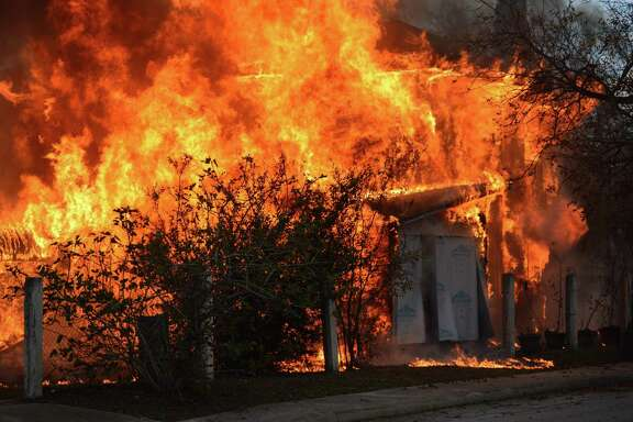 Firefighters respond to a fire at a house on West Travis in 2017. A reader says firefighters deserve more support and empathy from city officials with cushy jobs.