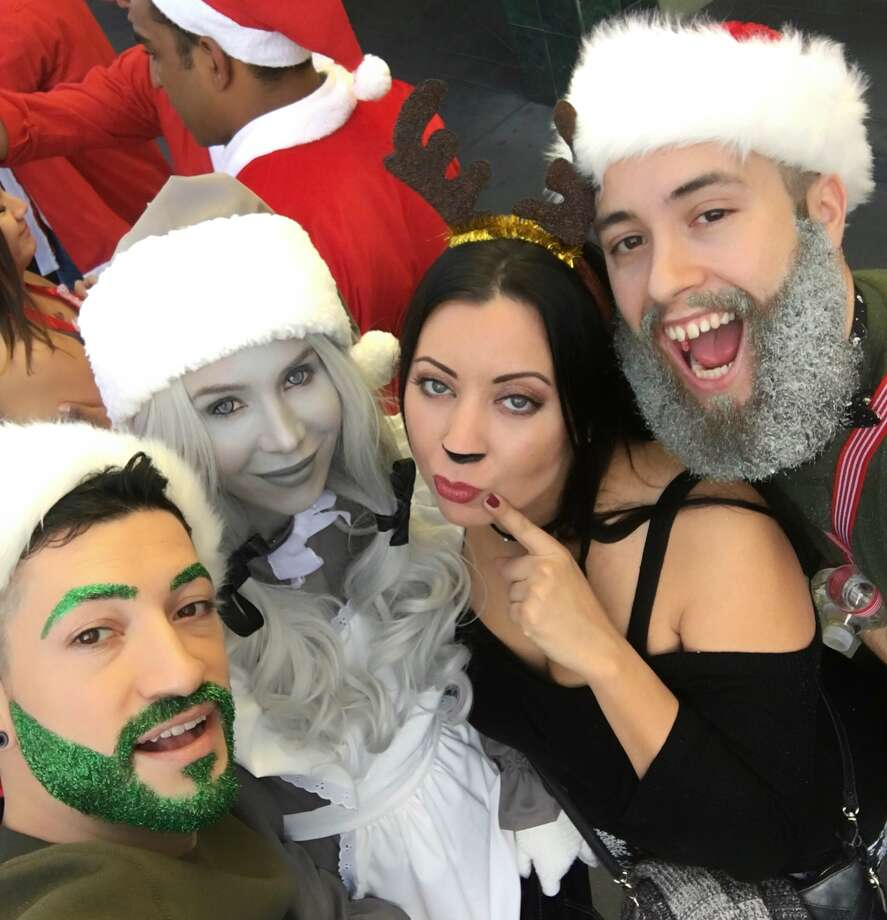 Christine Noel, a beauty blogger and San Francisco resident, wowed San Francisco SantaCon participants on Sunday, Dec. 10, 2017 with her greyscale costume. Photo: Courtesy Christine Noel
