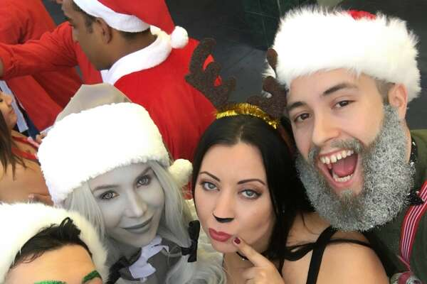 Christine Noel, a beauty blogger and San Francisco resident, wowed San Francisco Santa Con participants on Sunday, Dec. 10, 2017 with her greyscale costume.
