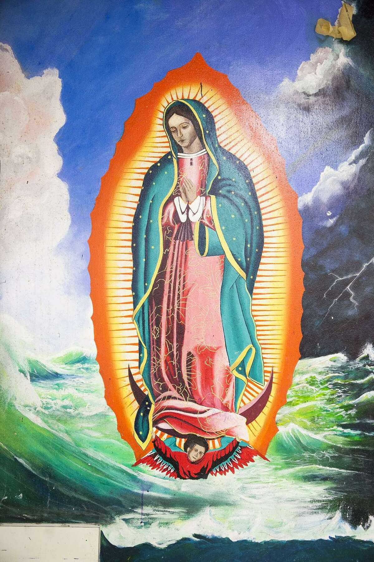 """""""Virgen de Guadalupe"""" mural painted in 1977 at Lanier High School. It was produced by Lanier High School artists as part of a class project."""