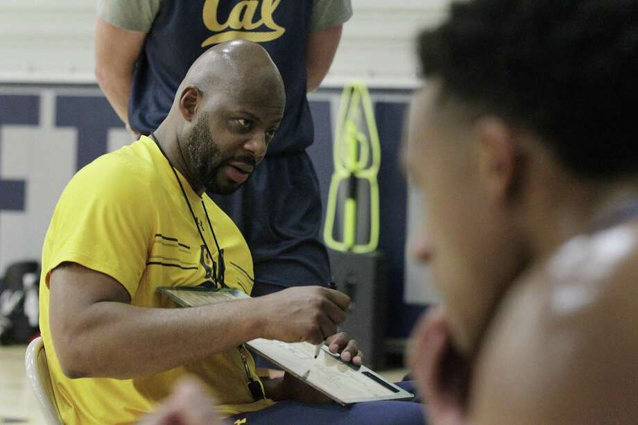 Cal Golden Bears men's head basketball coach Wyking Jones (left) talks with team members during practice at the UC Berkeley Recreational Sports Facility on Wednesday, November 8,  2017 in Berkeley, Calif. Photo: Lea Suzuki / The Chronicle / ONLINE_YES