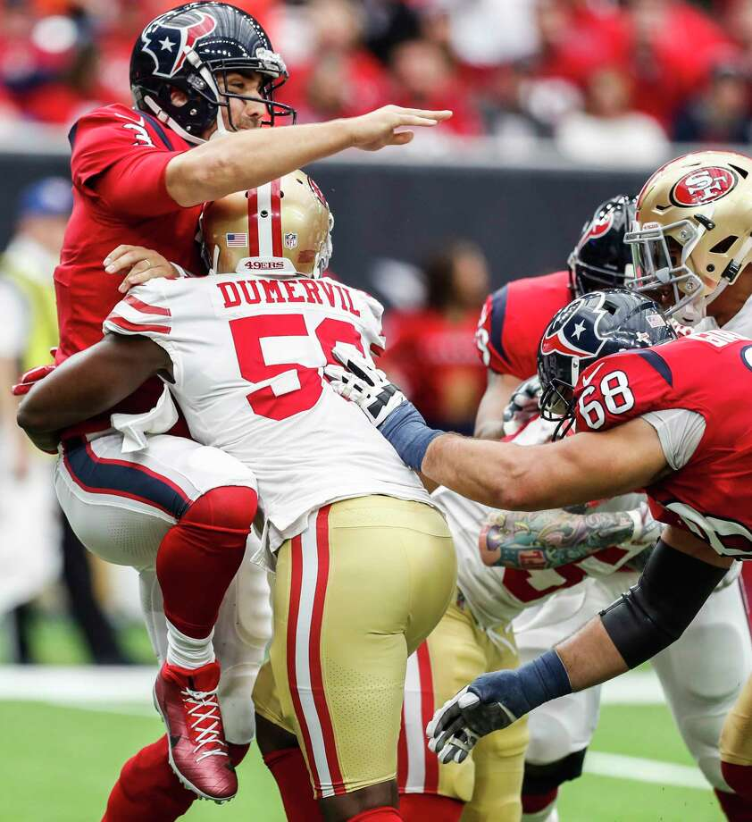Texans quarterback Tom Savage went to the sideline after being hit by 49ers defensive end Elvis Dumervil, but he returned to the field for one series. Photo: Brett Coomer, Staff / © 2017 Houston Chronicle