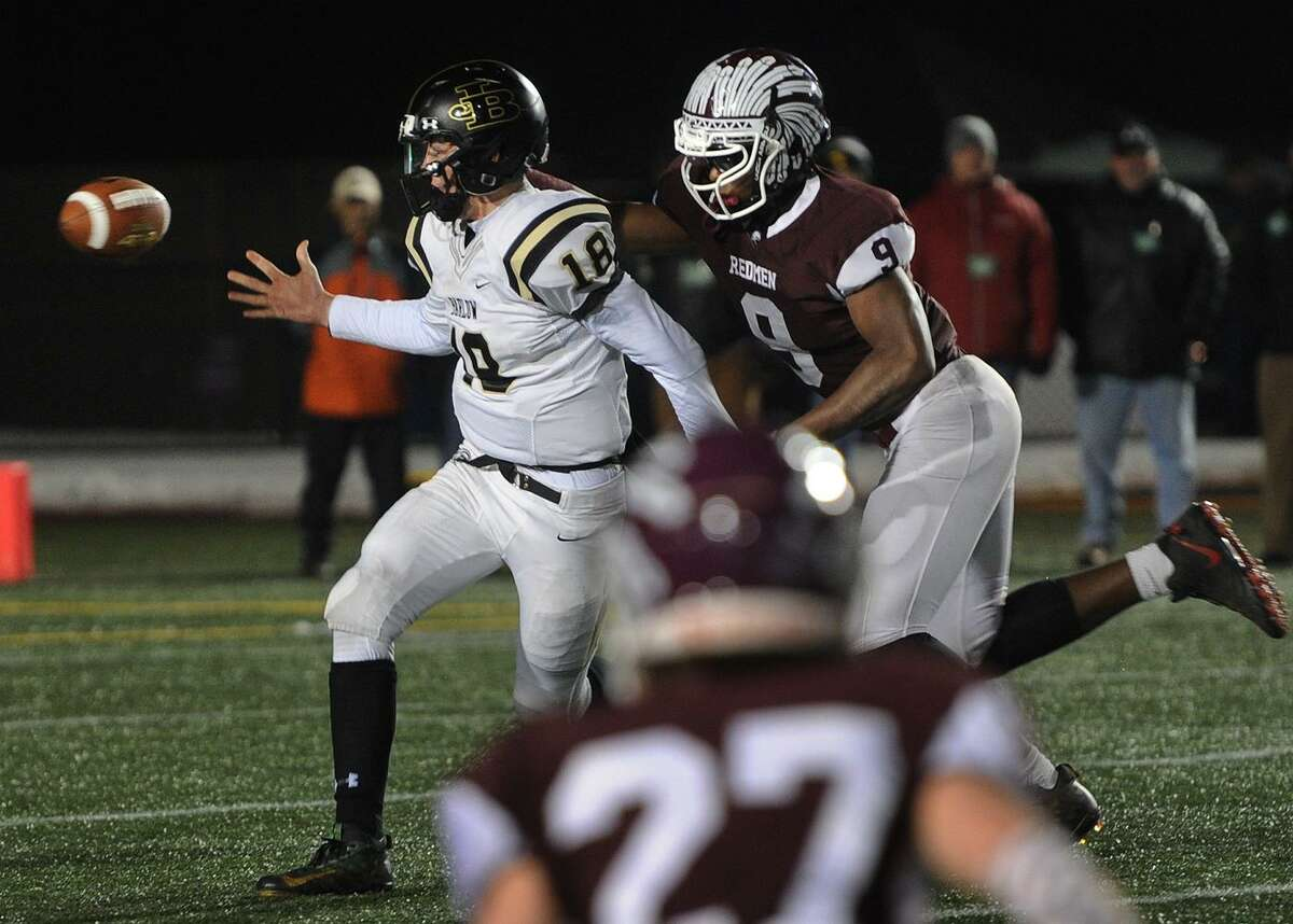 Joel Barlow quarterback Trevor Furrer has the ball stripped by Killingly defender Nsaiah Harriet in the first half of the CIAC Class M State Championship game at Veterans Stadium in New Britain, Conn. on Monday, December 11, 2017.